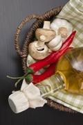 Stock Photo of vegetables and  basket with  bottle of vinegar