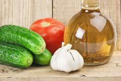 vegetables and a bottle of oil, still life - stock photo