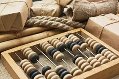 Pile parcel wrapped with brown kraft paper and abacus Stock Photos