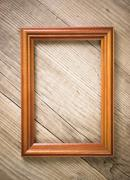 old picture frame on a wooden background - stock photo