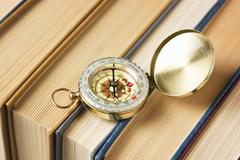 compass and old books - stock photo