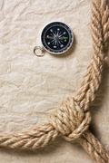 compass, old paper and rope - stock photo
