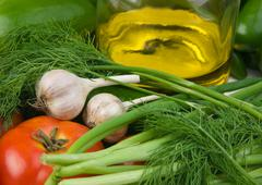 vegetables and a bottle of oil - stock photo