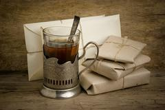 glass of tea and post envelopes - stock photo