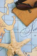 Passport and sunglasses on map Stock Photos