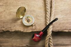 Stock Photo of old tobacco pipe and compass