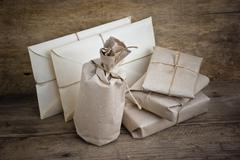 Pile parcel wrapped Stock Photos