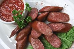 Chopped sausages Stock Photos