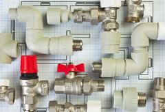 Plumbing fittings on the drawing Stock Photos