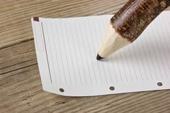 Stock Photo of note and wooden pencil