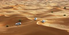 jeep safari in the sand dunes of the arabian desert in dubai - stock photo