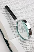 Stock Photo of books and magnifying glass