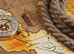 Compass and rope on map Stock Photos