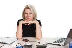 mature business woman working in the office isolated - stock photo