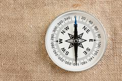 compass on old canvas - stock photo