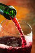 Red wine being poured into wine glass Stock Photos