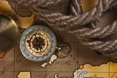 compass and rope on map - stock photo