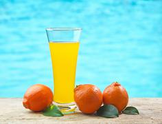 tangerine and juice - stock photo
