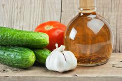 Vegetables and a bottle of oil, still life Stock Photos