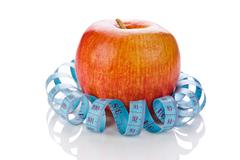 Blue measure tape and red apple  isolated Stock Photos