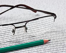 glasses and  pencil - stock photo