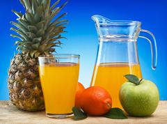 Stock Photo of fruit and juice on a wooden table