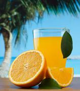 Stock Photo of orange juice on a beach