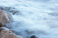 Stock Photo of surf on rocky shore