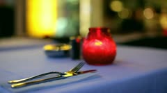 Silverware at candle light dinner Stock Footage