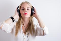 image of woman listening to music - stock photo