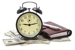 Alarm clock and money isolated Stock Photos