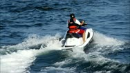 Jet Skier rides through the water Stock Footage
