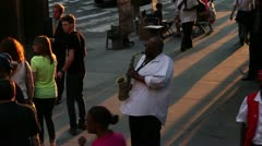 Saxophone player busking on the streets of New York Stock Footage