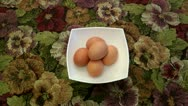 Five boiled eggs for food. The person cleans the first egg from a shell Stock Footage