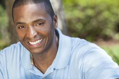 Happy african american man smiling Stock Photos