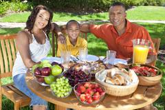 African american family eating healthy food outside Stock Photos