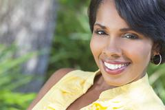 beautiful african american woman relaxing outside - stock photo