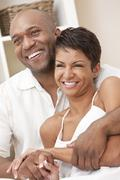 Happy african american man & woman couple Stock Photos