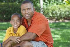 happy african american father and son family outside - stock photo