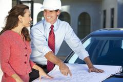 Woman & man in hard hat on construction site Stock Photos