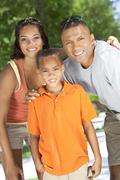 african american family parents with boy son - stock photo