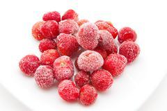 Sweet, luscious frozen strawberries on white Stock Photos
