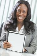 African american woman using tablet computer Stock Photos
