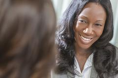 african american woman or businesswoman in meeting - stock photo