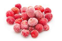 Sweet, luscious frozen strawberries on white background Stock Photos