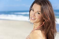 Sexy brunette girl on a beach in sunshine Stock Photos