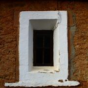 The window of an old church. Stock Photos