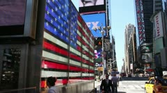 Stars and Strips on the side of the military recruitment booth in times square Stock Footage