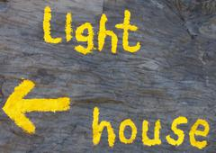 Lighthouse: writing on a wall. Stock Photos
