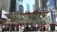 Tourists queuing for tickets at the TKTS booth in Times Square - stock footage